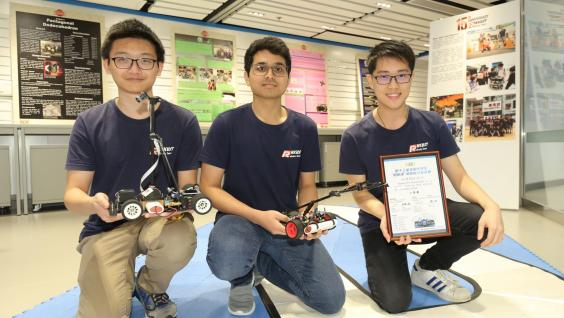 (From left) Daniel Cheung, Amrutavarsh Sanganabasappa Kinagi and Leslie Lee Chun-Hei, who won First Class Award in the 13th NXP Cup Intelligent Car Racing Competition (South China Region) held in Hubei province in July 2018, demonstrate their smart car in the Dream Team Open Lab
