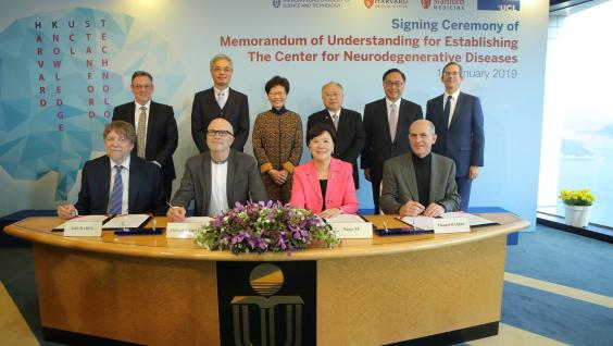 The Hon Mrs. Carrie LAM (back third left), Chief Executive of HKSAR; Mr. Andrew LIAO (back third right), HKUST Council Chairman; Prof. Wei SHYY (back second left), HKUST President; Mr. Nicholas W YANG (back second right), Secretary for Innovation and Technology; Mr. Andrew HEYN (back first left), British Consul General in Hong Kong and Mr. Thomas HODGES (back first right), Acting U.S. Consul General in Hong Kong witness the MoU signing between Prof. Nancy IP (front second right), HKUST Vice-President for Re
