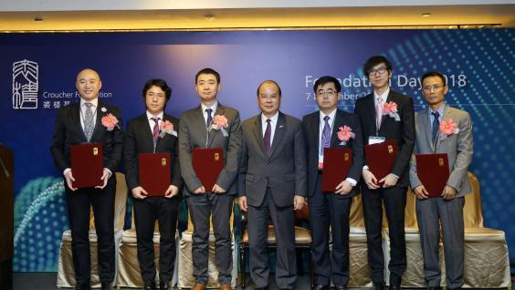 Mr. Matthew CHEUNG Kin-chung (middle), Chief Secretary of the HKSAR Government, presents research awards by Croucher Foundation to the winners this year: (from Left) Dr. Tjonnie LI Guang Feng, Dr. NGUYEN Tuan Anh, Dr. PAN Ding, Prof. MIAO Qian, Prof. Sydney TANG Chi Wai, Prof. WEN Zilong.