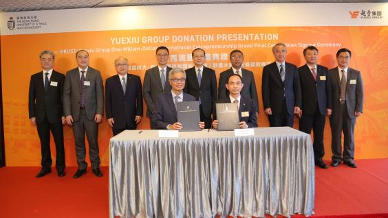 HKUST President Prof. Wei SHYY (front left) and Yuexiu General Manager Mr. ZHU Chunxiu (front right) sign the HK$100 million donation agreement under the witness of officiating guests including Mr. Kevin YEUNG Yun-Hung, Secretary for Education, HKSAR (back row, fourth left); Mr. YANG Jian, Deputy Director of the Liaison Office at the Central People's Government in the HKSAR (back row, middle); Mr. YANG Yirui, Deputy Commissioner of the Ministry of Foreign Affairs of the People's Republic of China in th