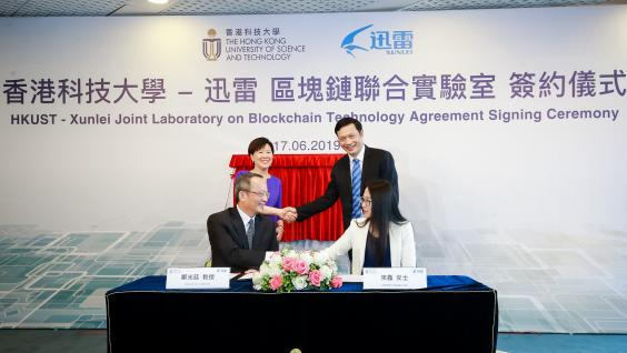 Prof. Tim CHENG, Dean of Engineering of HKUST (front left), and Ms. LAI Xin, ThunderChain's Chief Engineer of Xunlei (front right), sign the collaborative agreement to establish HKUST-Xunlei Joint Laboratory on Blockchain Technology, witnessed by Prof. Nancy IP, Vice-President for Research and Development of HKUST (back left), and Mr. CHEN Lei, Chief Executive Officer of Xunlei and Onething Technologies (back right).