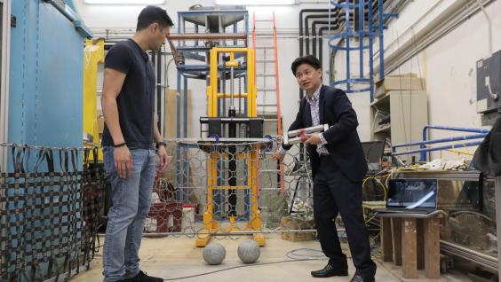 Prof. Charles Ng (right) and Dr. Choi explain how the newly-design multiple flexible barrier system work.