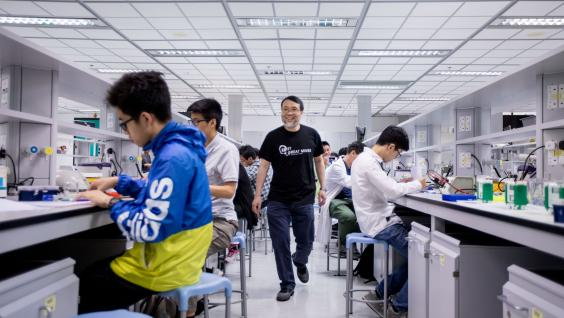 Prof. King Chow (Middle) wants to change the way biology is being taught and perceived in local schools by bringing in the International Biology Olympiad.