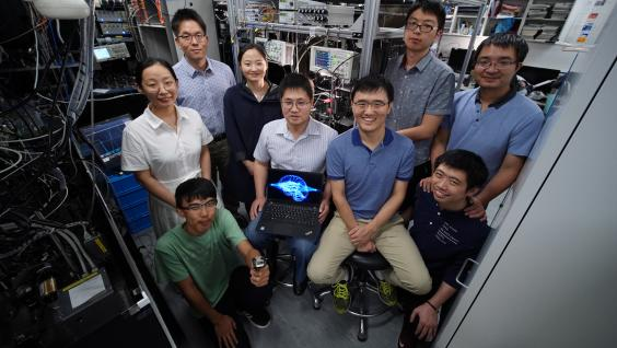Prof. DU Shengwang (middle left, seated), Prof. LIU Junwei (middle right, seated), Prof. JO Gyu-Boong (back left, standing) and their research team