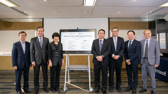 The signing ceremony is witnessed by Dr. David CHUNG Wai-Keung (first from left), Under Secretary for Innovation and Technology of the HKSAR Government; Mr. Alain CROZIER (second from left), Corporate Vice President, Chairman and CEO of Microsoft Greater China Region; and Prof. Lionel NI (fourth from right), Provost of HKUST.