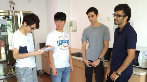 To overcome his fear of speaking in English, David Or (second left) proactively took part in the production of a mini-movie with some non-local students.