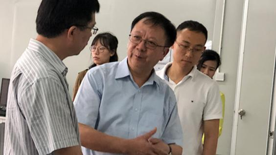 Prof. Wen (Middle) and Dr. Gao (right) introduce the theories behind their novel detection device in their research base at Shenzhen.