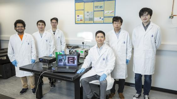 Prof. FAN Zhiyong (third from right), Dr. GU Leilei (second from right) and the research team.  (Stock photo)