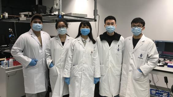 Prof. Huang (third left) and her research team.
