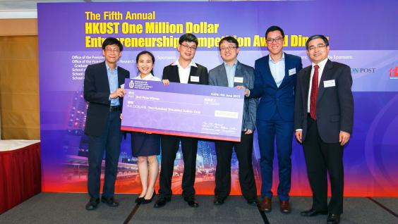 Department Head of Chemical and Biomolecular Engineering Prof Guohua Chen (right) presents the award to second place winner NanoPrint.