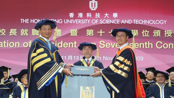 HKUST Council Chairman Dr Marvin Cheung (left) presenting the HKUST Ordinance to President Tony Chan (right). In the middle is Acting Chancellor Mr Henry Tang.