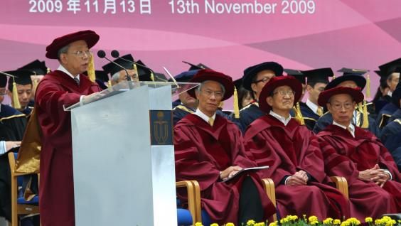 Dr John Chan (first from left, standing) addressing the Congregation on behalf of the Honorary Graduates. (from left) Prof Gregory Chow, Prof Daniel Tsui and Dr Joseph Yam