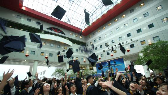 Graduates tossing their hats in jubilation as the Congregation concludes.