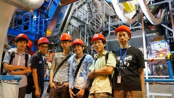 Part of the Hong Kong team in front of the ATLAS detector.