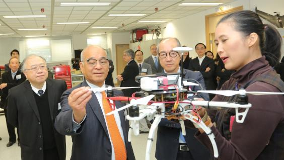 Dr Henry Cheng Kar-shun (second left), accompanied by HKUST Council Chairman the Honorable Andrew Liao Cheung-sing (first left) and President Prof Tony F Chan (third left), visit the Robotics Institute inside the building.
