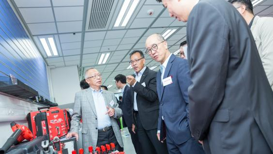 Prof Chung (first left) and Prof Chan (second right) visit the Undergraduate Student-initiated Experiential Learning (USEL) Laboratory among other guests.