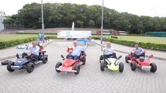The four judges of the competition take a ride on the cars that the students had built – (from left) Prof Tim Cheng; Prof Roy Chung; Mr Chow Tang Fai; and Prof Ben Chan, Associate Professor of Engineering Education and Associate Director of the Academy for Bright Future Young Engineers.