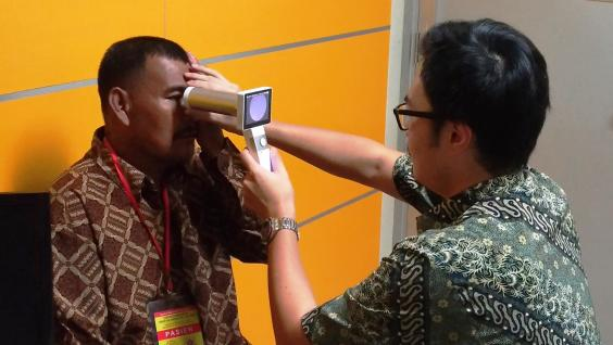 The student is testing the use of a portable fundus camera for diabetic retinopathy screening in a clinic in Indonesia.